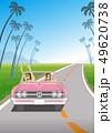 ピンクのオープンカーでドライブを楽しむ若い二人の女性 南国の道路 - コピースペースあり 49620738