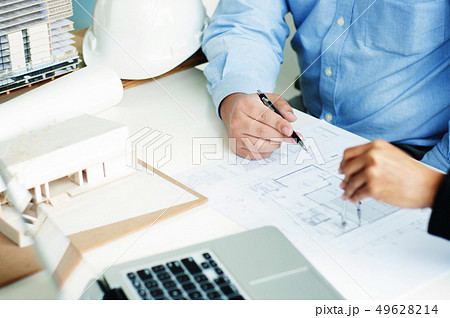 engineer architecture working with blueprint discussing about bu 49628214