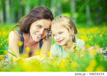 Mother and daughter on sunny meadow 49659154