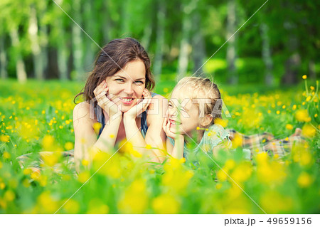 Mother and daughter on sunny meadow 49659156