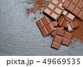 Dark or milk organic chocolate pieces and cocoa powder on dark concrete backgound 49669535
