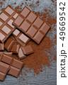 Dark or milk organic chocolate pieces and cocoa powder on dark concrete backgound 49669542