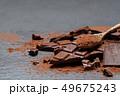 Dark or milk organic chocolate pieces and cocoa powder on dark concrete backgound 49675243