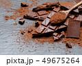 Dark or milk organic chocolate pieces and cocoa powder on dark concrete backgound 49675264