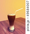 Iced coffee and cream in tall glass with straw on 49684007