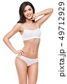 Fitness young woman with a beautiful body on white background 49712929