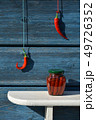 Canned glass jar on shelf and red hot chili pepper hand on wall 49726352