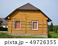 begin instaling wooden planks on old house for insulation materials 49726355