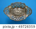 Vintage ornamental metal vase on blue background 49726359
