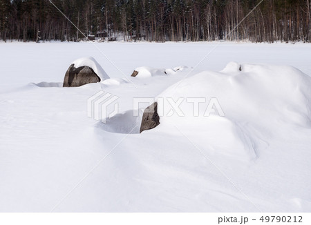 Shore stones covered by white snow 49790212