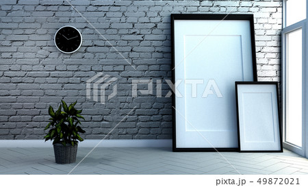 frames on brick wall and wooden wooden floor 49872021