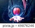 ビジネスマン りんご 浮かぶの写真 49876246