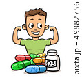 Boy flaunting his muscles with microelements and supplements in front of him. Fitness and healthy 49882756