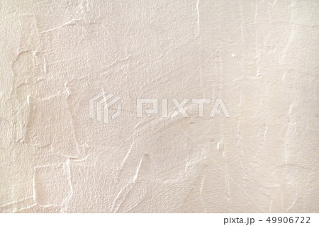 Rough surface plaster texture. Peachy pink light orange color background with copy space. Decorative 49906722