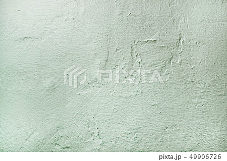 Rough surface plaster texture. Mint pastel light blue color background with copy space. Decorative 49906726