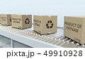 Boxes with PRODUCT OF VIETNAM text on roller conveyor. Vietnamese import or export related 3D 49910928