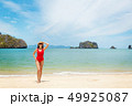 Young attractive woman relax on the sea beach 49925087
