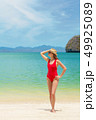 Young attractive woman relax on the sea beach 49925089