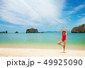 Young woman practice yoga on a beach 49925090
