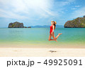 Young attractive woman jumping on the sea beach 49925091