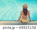 Young woman relaxing in swimming pool 49925138