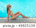 Young woman relaxing in swimming pool 49925139