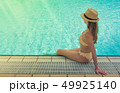 Young woman relaxing in swimming pool 49925140