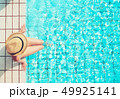 Young woman relaxing in swimming pool 49925141