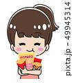 お菓子を食べる若い女性 49945314
