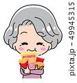 お菓子を食べるおばあさん 49945315