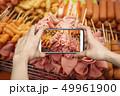 Ham and sausage sticks at street food market 49961900