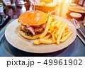 Beef burger with cheese and bacon  49961902