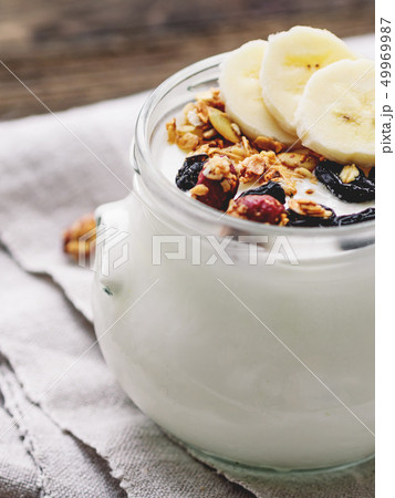 Natural homemade yogurt in a glass jar. Muesli 49969987