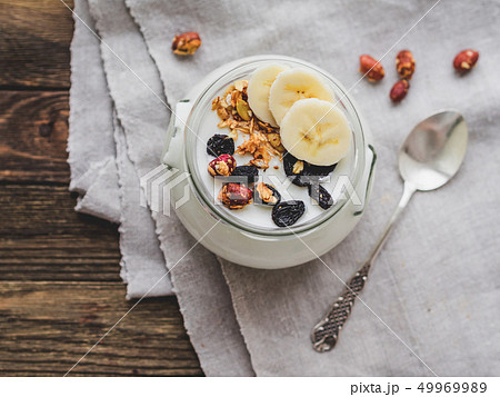Natural homemade yogurt in a glass jar. Muesli 49969989