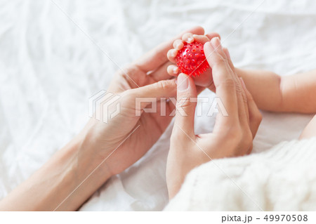 Mother holds newborn baby's hands. Tiny fingers 49970508