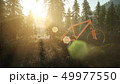 bicycle in mountain forest at sunset 49977550
