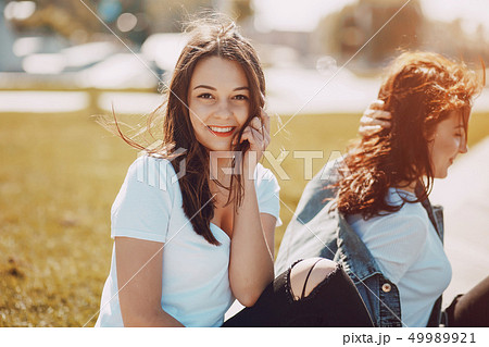 two girls talking 49989921