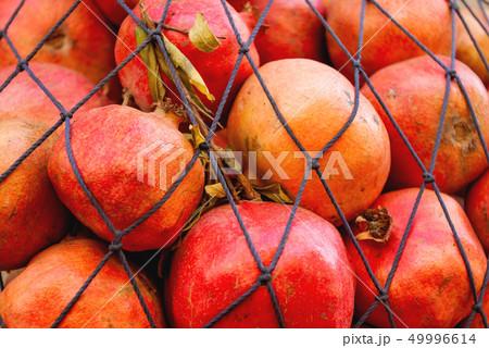 Woven bag with ripe pomegranates. Alexandria, 49996614