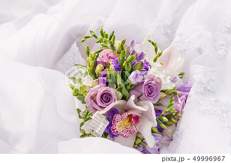 Bridal bouquet with violet freesia, lilac roses 49996967