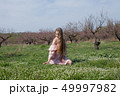 beautiful blonde woman collects spring color in the garden 49997982