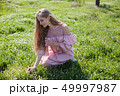 beautiful blonde woman collects spring color in the garden 49997987
