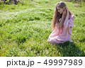 beautiful blonde woman collects spring color in the garden 49997989