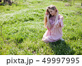 beautiful blonde woman collects spring color in the garden 49997995