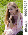 beautiful blonde woman collects spring color in the garden 49997997