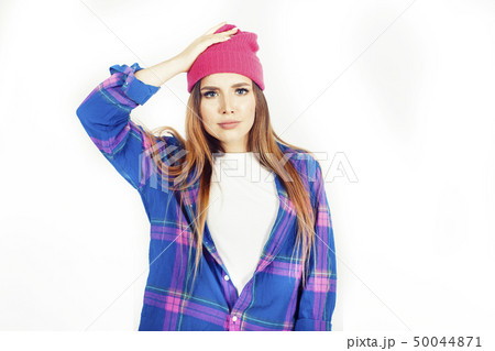 young pretty teenage hipster girl posing emotional happy smiling on white background, lifestyle 50044871