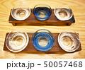 ガラスのお猪口に入った日本酒 50057468