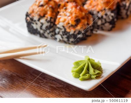 Wasabi sauce and rolls with eel, shiitake 50061119