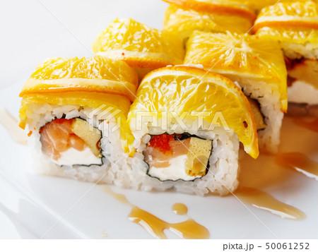 Rolls with rice, seaweed nori, salmon, cream 50061252