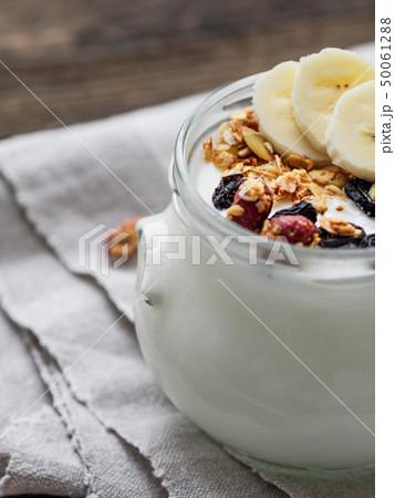 Natural homemade yogurt in a glass jar. Muesli 50061288