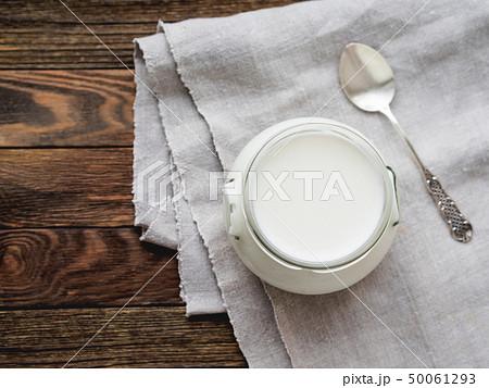 Natural homemade yogurt in a glass jar. Healthy 50061293